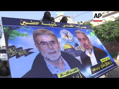 Download Islamic Jihad militants march in Gaza City