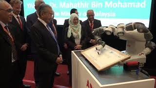 Malaysian Prime Minister launches international event with the help of YuMi