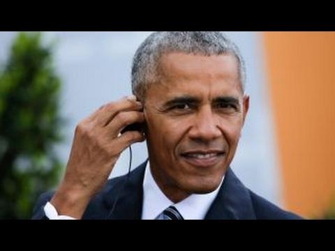 Get Obama takes swipe at Trump in Berlin Snapshots