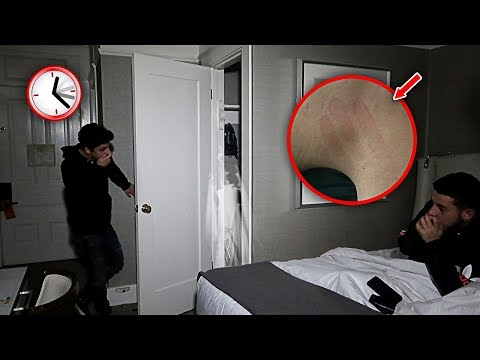 OVERNIGHT CHALLENGE IN THE MOST HAUNTED HOTEL ROOM.. **ATTACKED**