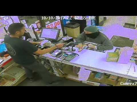 Video shows clerk grabbing gun, cash flying as robber flees store