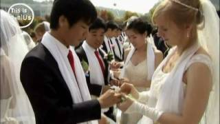 10,000 marriages: Big white wedding for Unification Church