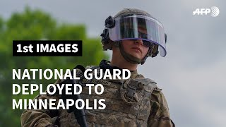 National Guard deployed to Minneapolis stand guard after violent protests overnight | AFP