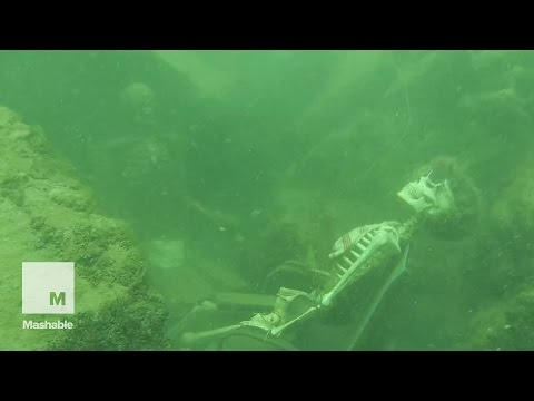 Scuba diver stumbles on underwater armchair skeletons   Mashable