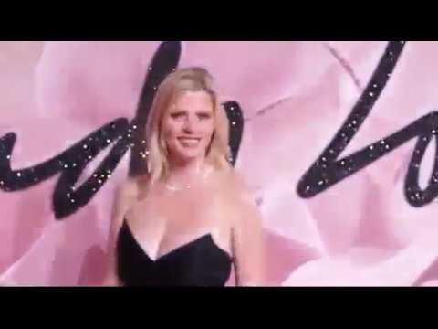 Lara Stone struts down the red carpet in playful minidress Fashion Awards 2016