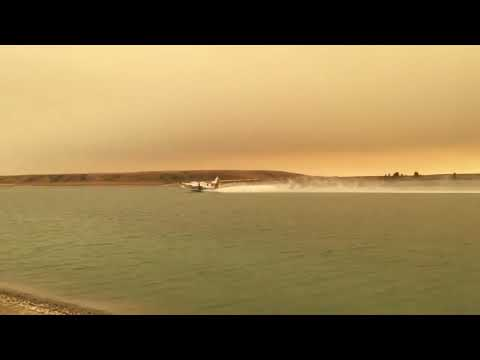 Water bombers filling up at the Waterton Dam - Lewis Anderson video