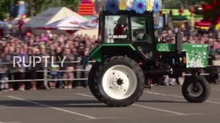 Belarus: Synchronised TRACTORS plie and pirouette to Tchaikovsky in graceful agro-ballet