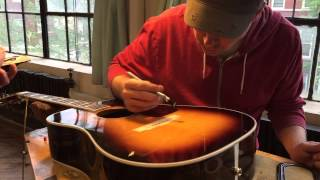 Regluing A Bridge On An Acoustic Guitar