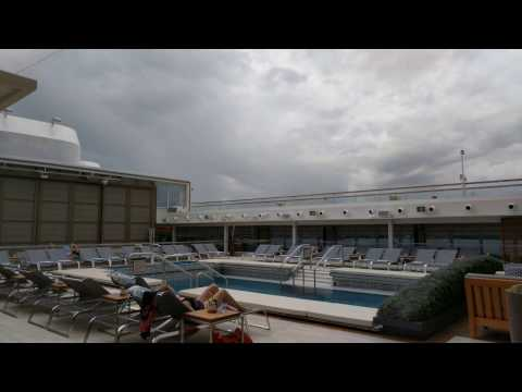 Time lapse: bad weather approaches cruise ship, dome is closed over pool