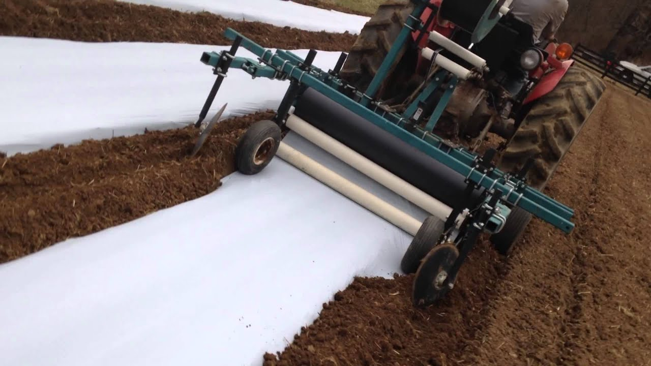 How To Install A Plastic Weed Barrier With A Tractor