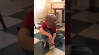 A Montessori Student Ties His …