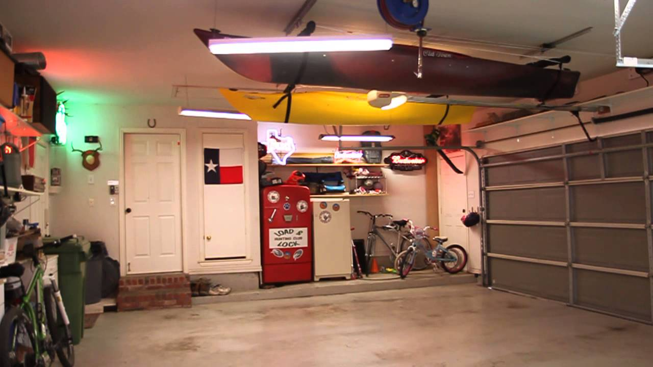 Kayak hoist storage youtube for Apartment garage storage