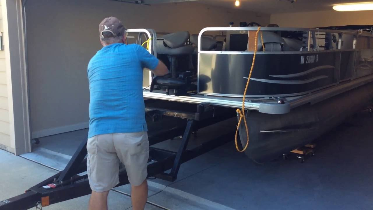 Store a 20 39 pontoon in a 2 car garage youtube for Boat storage garage