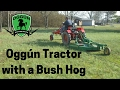 Oggún Tractor with a brush hog (Deere MX5 Rotary Cutter)