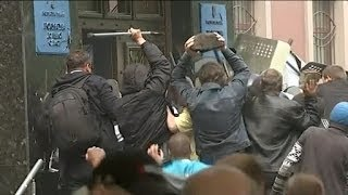 Riot police surrender to protesters in Donetsk chaos | ITV News