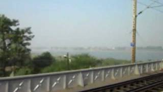 INDIAN RAILWAYS:Crossing Yamuna River and Kalka Mail led by WAP7 30230 on Sangam Bridge
