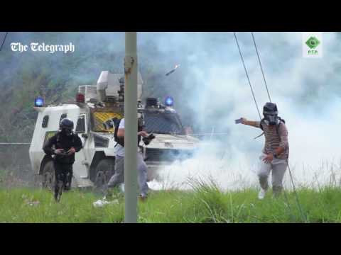 Venezuela crisis: protesters hurl 'Molotov cocktails' at armoured tank