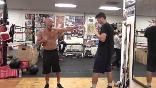 how to throw the powerful short hook like mike tyson - EsNews boxing