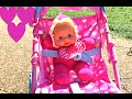 Little Girl / PUSHING STROLLER with BABY DOLL  / Playground / Having Fun /
