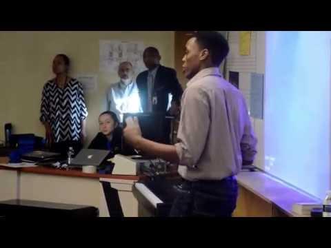Tinashe speaking at Milwood Magnet School