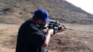 Shooting the Sig Sauer AR-15 with a holographic sights with custom reticle. Very accurate!