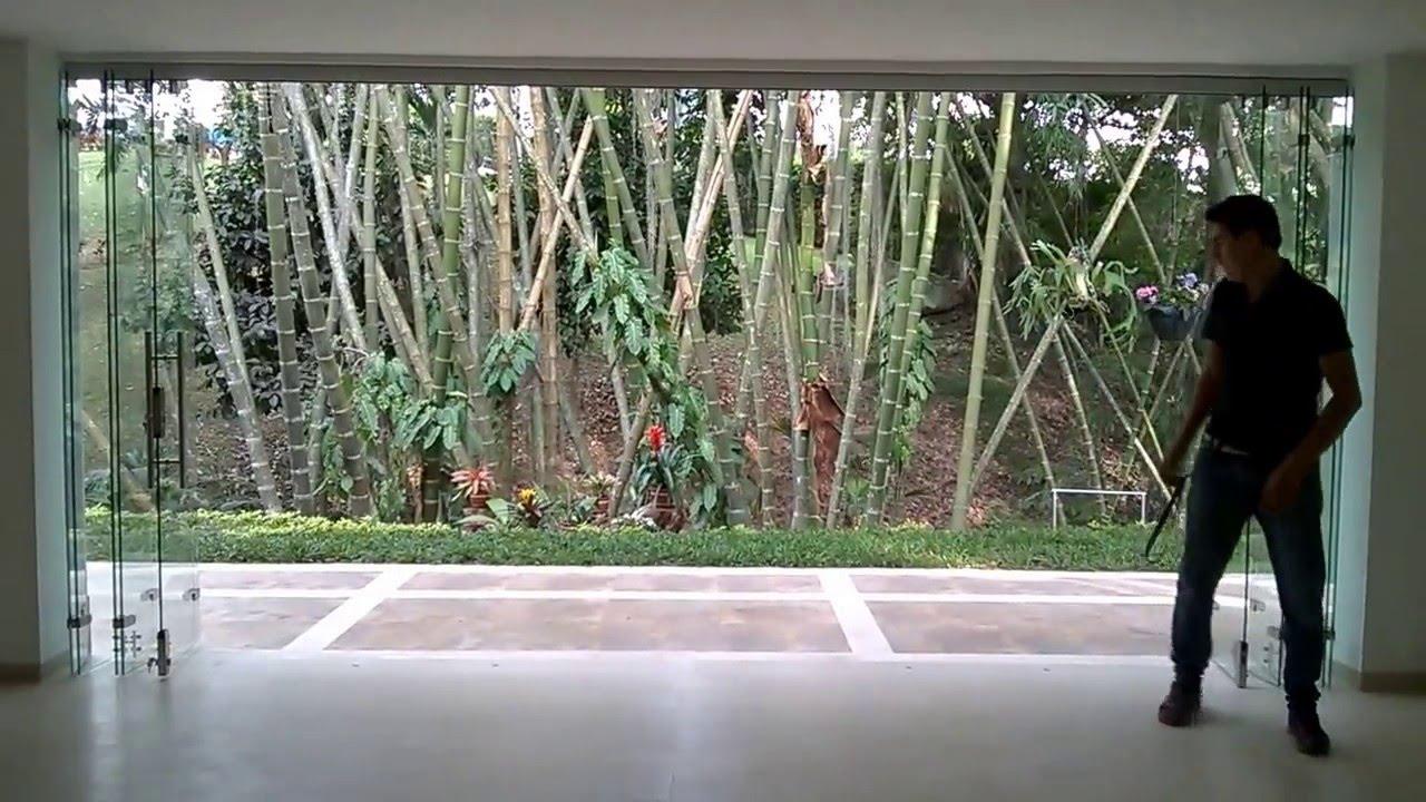 Puertas plegables en vidrio bucaramanga youtube for Puertas en madera y vidrio