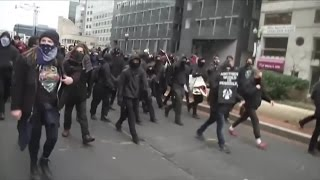 RAW: Protesters March Through Streets During Inauguration In Washington D.C.