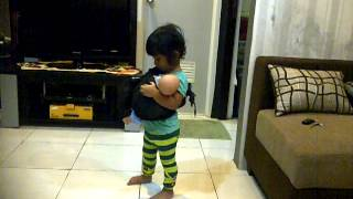 Felicia playing with her doll pretend like mommy