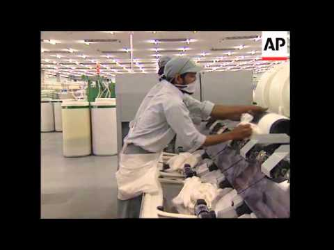 INDIA: TEXTILE MANUFACTURER'S EMPLOYEE'S GIVEN ROLLER SKATES