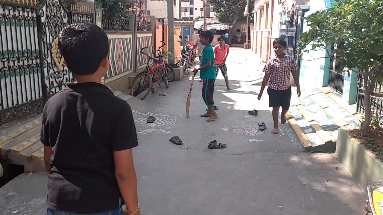 Children playing street cricket
