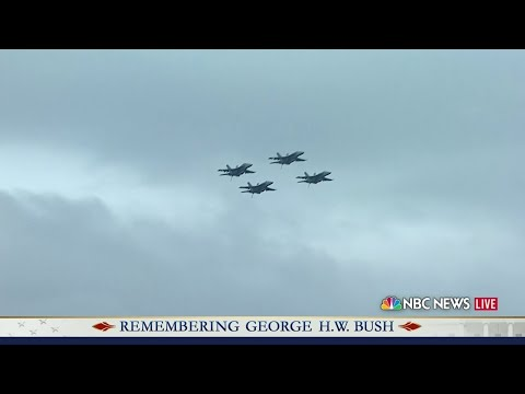Bush's casket taken off train to garden. Missing man formation