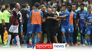 Nice vs Marseille abandoned after fans throw projectiles and invade the pitch