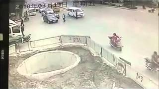 Scooter man goes full retard and crashes in to giant hole