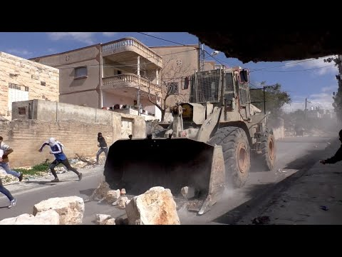 Israeli Army Bulldozer Pushes Boulders At High Speed Towards Protesters, Qadum, 21 Feb. 2020