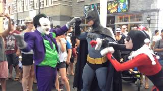 Harley Quinn and the Joker fight against Batman at Movieworld