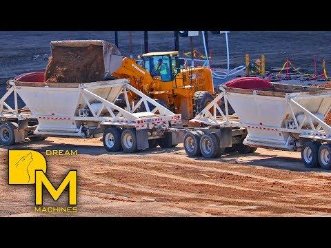 HEAVY MACHINES IN LAS VEGAS WHEEL LOADER MOVING DIRT & LOADING DUMP TRUCKS ON HUGE CONSTRUCTION SITE