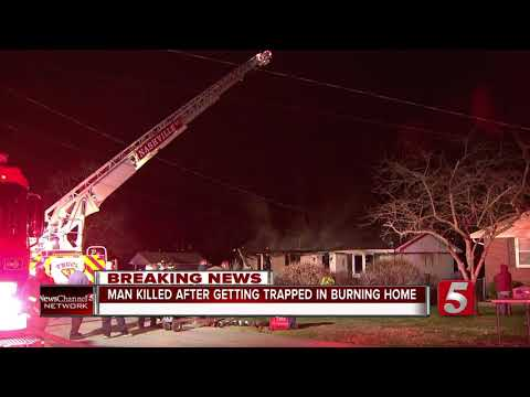 Man trapped in burning home dies overnight