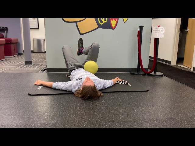 Unilateral Glute Bridge with Ball Tucked in Hip