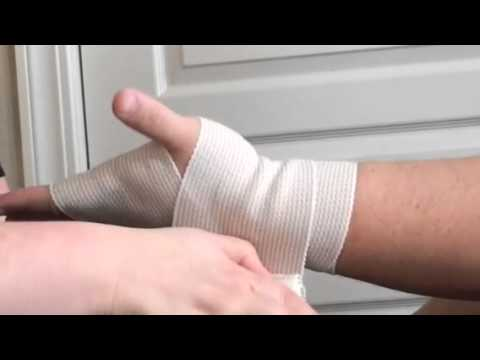 Applying a Figure 8 Elastic Bandage to an Injured Wrist