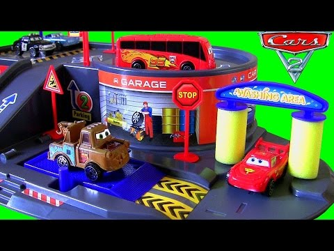 DisneyPixarCars Auto Parking Garage Playset with Lightning McQueen Piston Cup Bus Unboxing