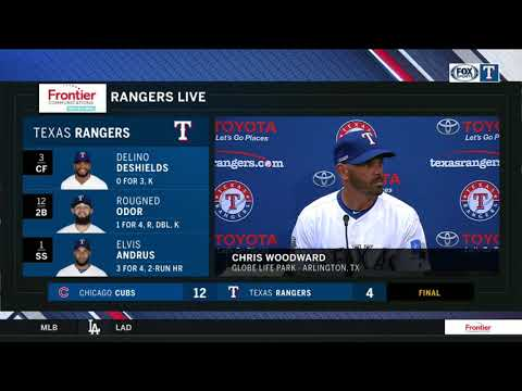 Chris Woodward reacts following Texas Rangers' 12-4 loss to the Chicago Cubs on Opening Day