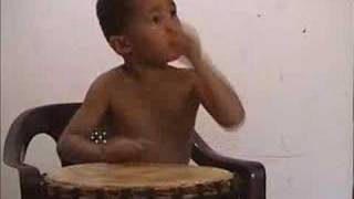4 Year Old Djembe Drummer(Isaiah Chevrier from www.rootsyrecords.com play solo djembe., 2006-06-13T15:34:38.000Z)