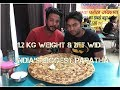 watch he video of India's biggest paratha | 1.2Kg weight | 2ft wide | Tapasya paratha junction