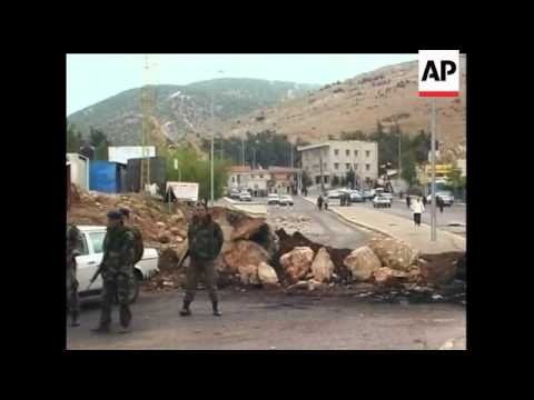 Hezbollah says it is withdrawing its fighters from the Beirut neighborhoods it seized in recent sect