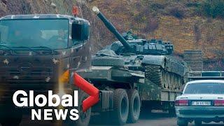 Nagorno-Karabakh conflict: Armenians flee area as Russian peacekeepers meet Azeri soldiers in Shusha