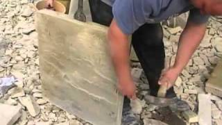 stoneuk.com - Splitting a new riven York stone paving flag