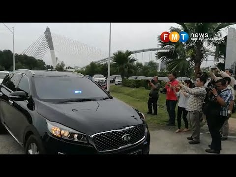 Frenzy of activity as top cops arrive at Dr M's office