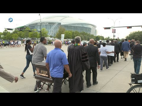 Activists protest Botham Jean shooting outside AT&T Stadium
