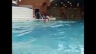 Kid swimming at his mom. Малыш плывет верхом на своей маме.