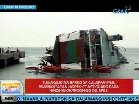 UB: Tumagilid na barko sa Calapan Pier, binabantayan ng PCG para hindi magkaroon ng oil spill